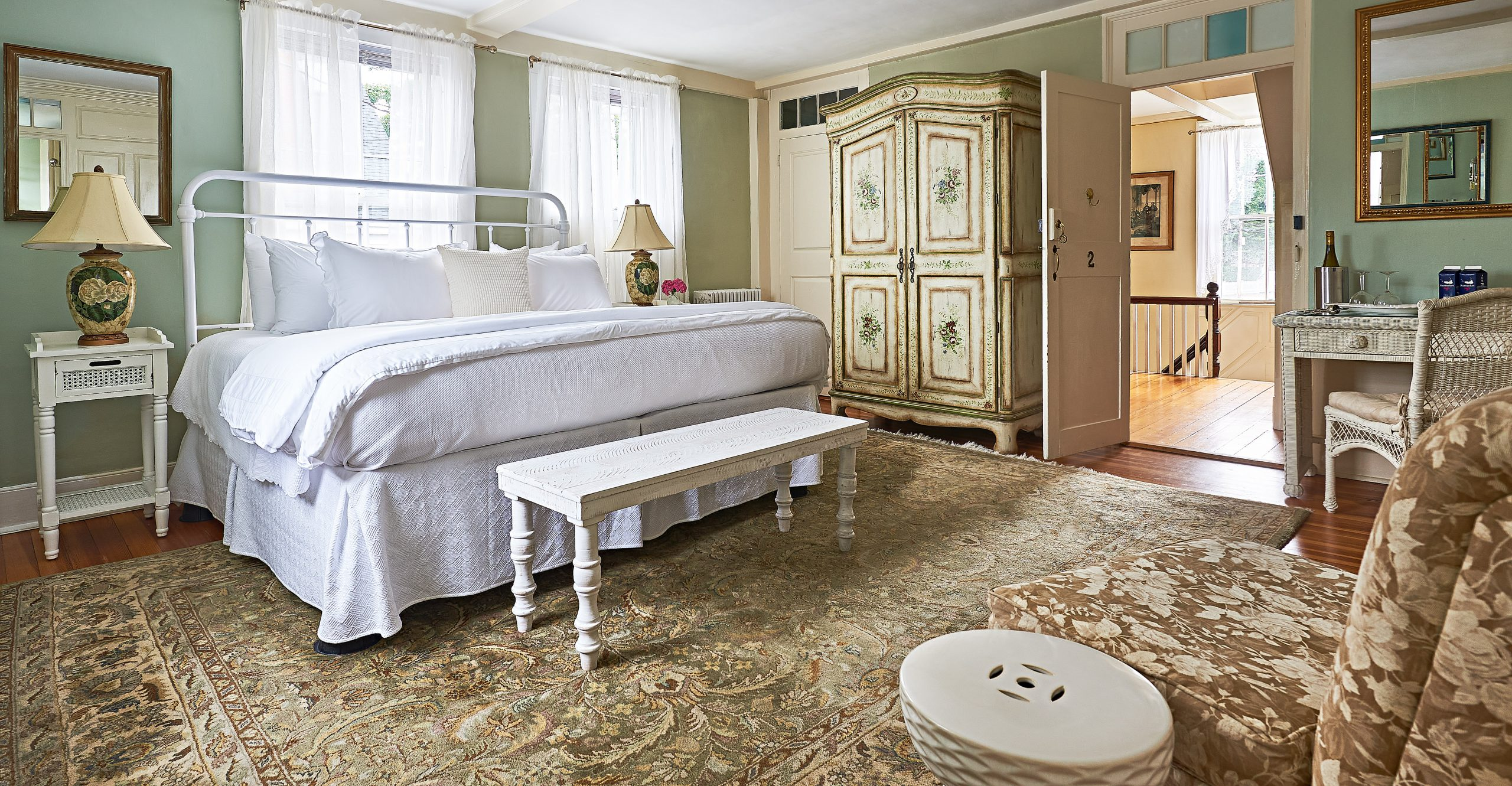 Large room with a bed and a wardrobe